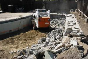 Salinas pool demolition job in progress